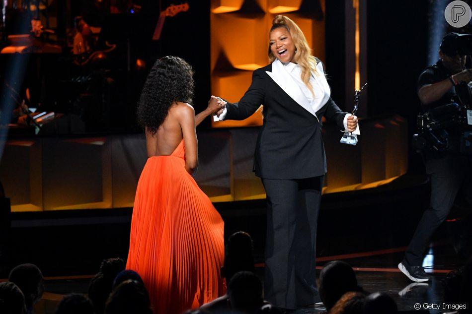 Robe de soirée orange dos nu Naomi Campbell