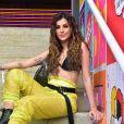 Looks dos famosos do Lollapalooza: Nah Cardososo foi certeira ao apostar em calça cargo amarela, cinto, coturno e top