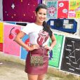 Looks dos famosos do Lollapalooza: Thaynara OG apostou no animal print nos acessórios, saia de couro vinho e t-shirt divertida em visual fashionista