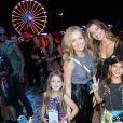 Grazi Massafera, além de ir com a filha, Sophia, ao Rock in Rio, marcou presença no festival com Caio Castro