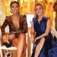 Juliana Paes assiste desfile de moda com Monique Alfradique