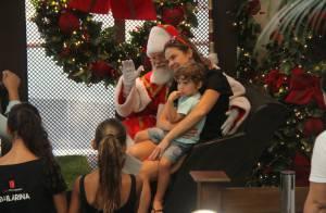 Leticia Birkheuer leva o filho, João Guilherme, para tirar foto com Papai Noel