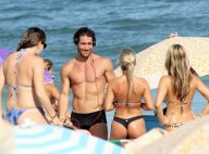 Flávio Canto mostra boa forma na praia rodeado de mulheres no Rio