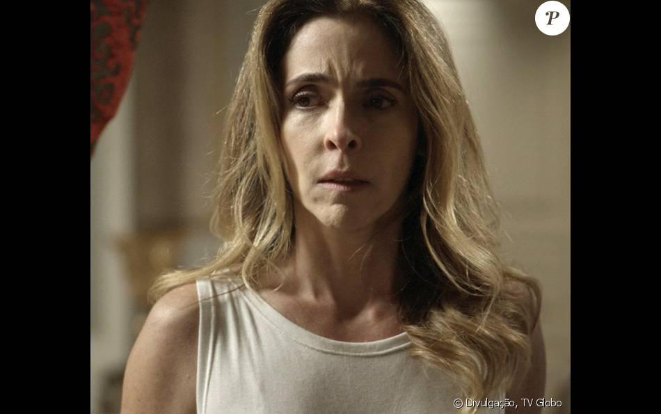 Kiki (Deborah Evelyn) revela para Dante (Marco Pigossi) que Gibson (José de Abreu) é o Pai da facção, na novela 'A Regra do Jogo'