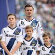 David Beckham posando com os filhos Brooklyn, Romeo and Cruz Beckham