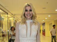 Flávia Alessandra exibe pernas definidas com look curto em evento de moda. Fotos