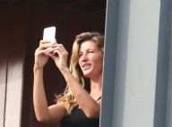 Gisele Bündchen aparece sem maquiagem e fotografa praia de varanda de hotel