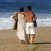 Débora Nascimento vai à praia em Noronha com José Loreto usando look comportado