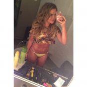 Fernanda Souza publica foto de biquíni e exibe abdômen sarado