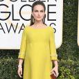 Grávida, a atrizNatalie Portman usou um longo amarelo da grife Prada