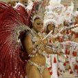 Viviane Araújo é um ícone do Carnaval. Ela desfila à frente da bateria do Salgueiro desde 2008 e inova tocando tamborim na Avenida. Na foto, Vivi no desfile de 2009