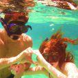 Marina publicou a foto de mergulho com o namorado, Klebber Toledo para comemorar o Valentine's Day