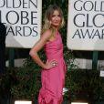 No Globo de Ouro de 2009, Cameron Diaz arrasou com este vestido cor-de-rosa da Chanel. A clucth e os sapatos são assinados por René Caovilla