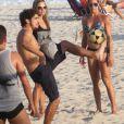 Caio Castro joga bola em tarde com amigos, na Praia do Pepê, na Barra da Tijuca, em 16 de junho de 2013