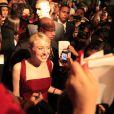 Dakota Fanning ficou rodeada de jornalistas e fotógrafos no Festival do Rio