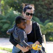 Sandra Bullock está em novo processo de adoção. Veja famosos com filhos adotivos