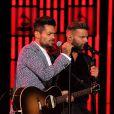 Draco Rosa se apresentou no Grammy Latino ao lado de Ricky Martin, seu companheiro nos tempos de Menudo
