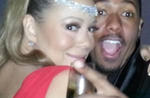 Mariah Carey posa com marido, Nick Cannon, e taça de champanhe: 'Feliz ano novo'