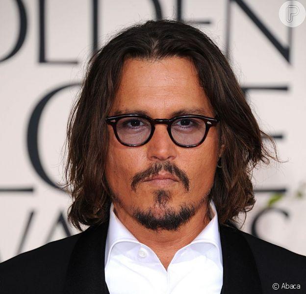 Johnny Depp foi trocado por outra mulher, segundo informações do jornal 'The Sun' deste sábado, 19 de janeiro de 2013