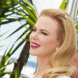 Nicole Kidman posa com simpatia para fotos durante o lançamento do filme 'Grace: A Princesa de Mônaco' no Festival de Cannes (14 de maio de 2014)