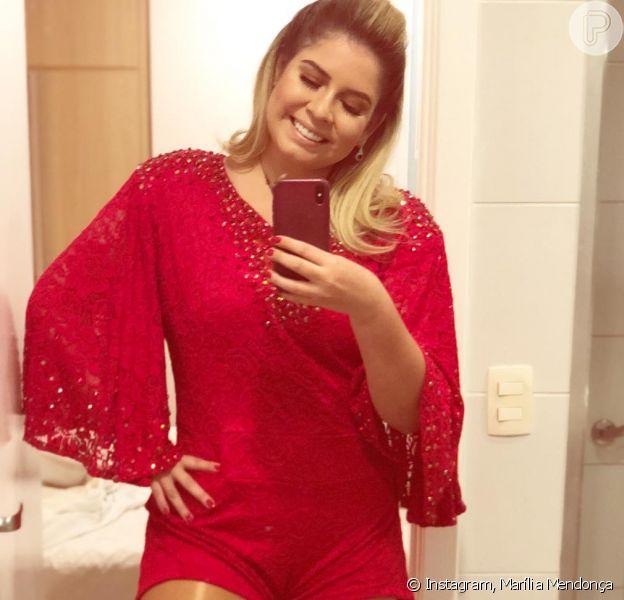 Com a silhueta mais magra, Marília Mendonça recebeu uma chuva de elogios ao postar foto do look na web, na madrugada deste domingo, 10 de junho de 2018. 'Vermelho. Porque eu sou apaixonada por Manaus', escreveu ela no post