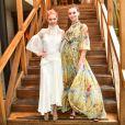 Camila Queiroz e Laura Neiva apostaram em vestidos fluidos para o evento da revista 'Vogue Noivas', da qual são capa