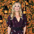 Elegante: o vestido longo vinho com flores brancas foi a escolha de Molly Sims Veuve Clicquot Polo Classic, que aconteceu em Los Angeles no último sábado, 6 de outubro de 2018