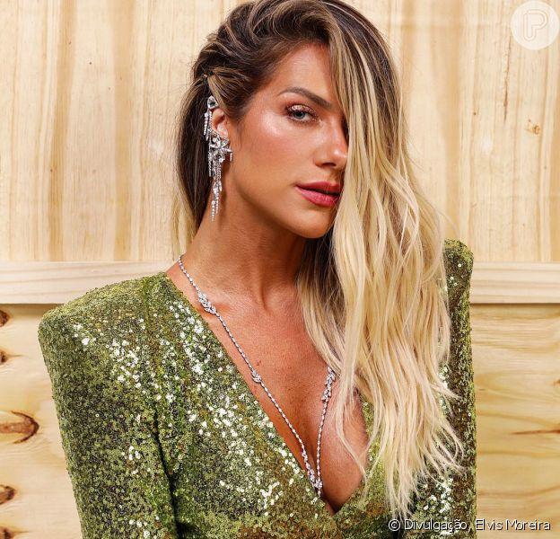 Giovanna Ewbank elegeu um vestido de paetê da marca Zhivago para acompanhar o marido, Bruno Gagliasso, na festa de lançamento da novela 'O Sétimo Guardião'