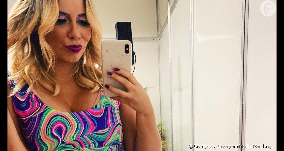 Marilia Mendonça entra em vestido justo e comemora em vídeo nesta sexta-feira, dia 19 de abril de 2019