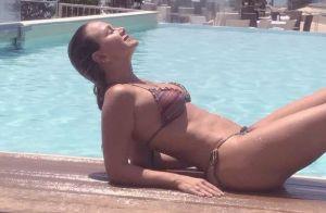 De biquíni, Eliana renova bronzeado ao curtir dia de piscina na Itália. Foto!