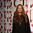 Letícia Birkheuer apostou em um look all black com transparência no decote
