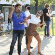 Anitta foi votar com o amigo David Brazil