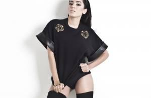 Anitta posa sensual para capa de revista e deixa pernas à mostra com look preto