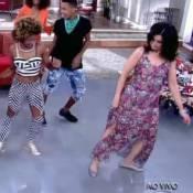 'Encontro': Fátima Bernardes aprende a dança do passinho e deixa pernas à mostra