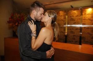 Fernanda Lima e Rodrigo Hilbert trocam beijos em evento de Dia dos Namorados