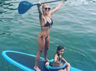 Flávia Alessandra exibe boa forma ao praticar stand up paddle com a filha Olívia