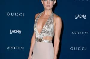 Kate Hudson aparece com vestido superdecotado em evento de cinema nos EUA