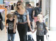 Fernanda Lima e os filhos gêmeos se divertem antes de embarcar no Rio. Fotos!