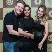 Michel Teló e Thais Fersoza curtem juntinhos o show de Sandy em SP