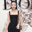 Jing Li prestigiou o desfile de alta-costura que celebrou os 70 anos da Dior, em Paris, na França, em 3 de julho de 2017