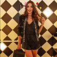 Macaquinhos com casacos bordados e botas podem criar um visual superprático e arrumado, como o de Marina Moschen