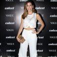 Camila Coutinho usou brincos Jack Vartanian, top cropped vazado e calça de babados Colcci no lançamento da coleção primavera/verão 2018 da marca e da edição de agosto da revista 'Vogue', em São Paulo, em 1° de agosto de 2017