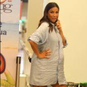 Grávida de 6 meses, Ivete Sangalo faz graça para paparazzo em aeroporto. Fotos!