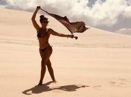 Juliana Paes exibe boa forma de biquíni e brinca com pose em praia: 'Tieta'