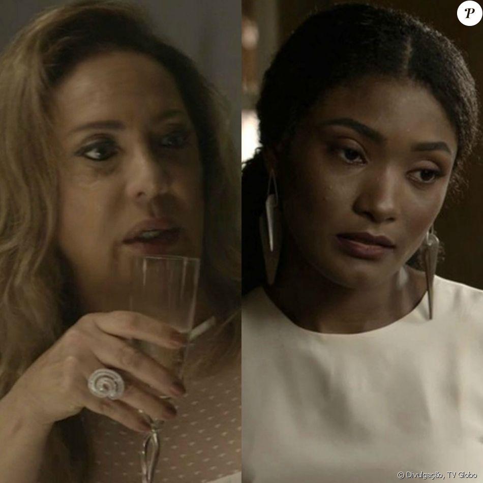 Nádia (Eliane Giardini) celebra com champanhe o atropelamento de Raquel (Erika Januza), namorada de Bruno (Caio Paduan), na novela 'O Outro Lado do Paraíso'