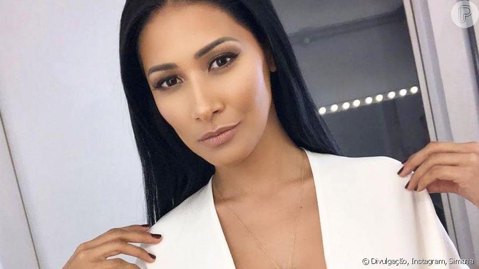 Dupla de Simone, Simaria usa look all black com decote poderoso em show neste domingo, dia 09 de junho de 2019
