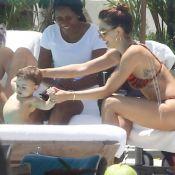 Isis Valverde curte piscina de hotel com o filho, Rael, e o marido. Veja!