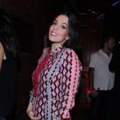 Mulher de Alexandre Nero, Karen Brusttolin exibe barriga de grávida em festa