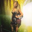 Andressa Suita curtiu o show da banda Queen, no Rock in Rio, de vestido e bota
