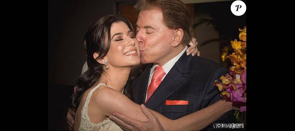 Renata Abravanel recebe o carinho pai, Silvio Santos, no dia de seu casamento, realizado no último sábado, 26 de setembro de 2015